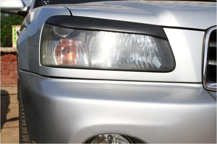 Накладки на передние фары Subaru Forester 2002-